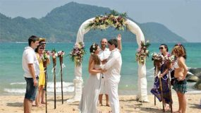 Pictures of people getting married on a beach